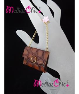 Broche bolsito de piel, cadena y motivo chapada en oro 18K modelo Coco Brown